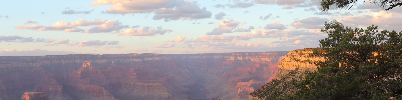 sun slowly setting at Grand Canyon